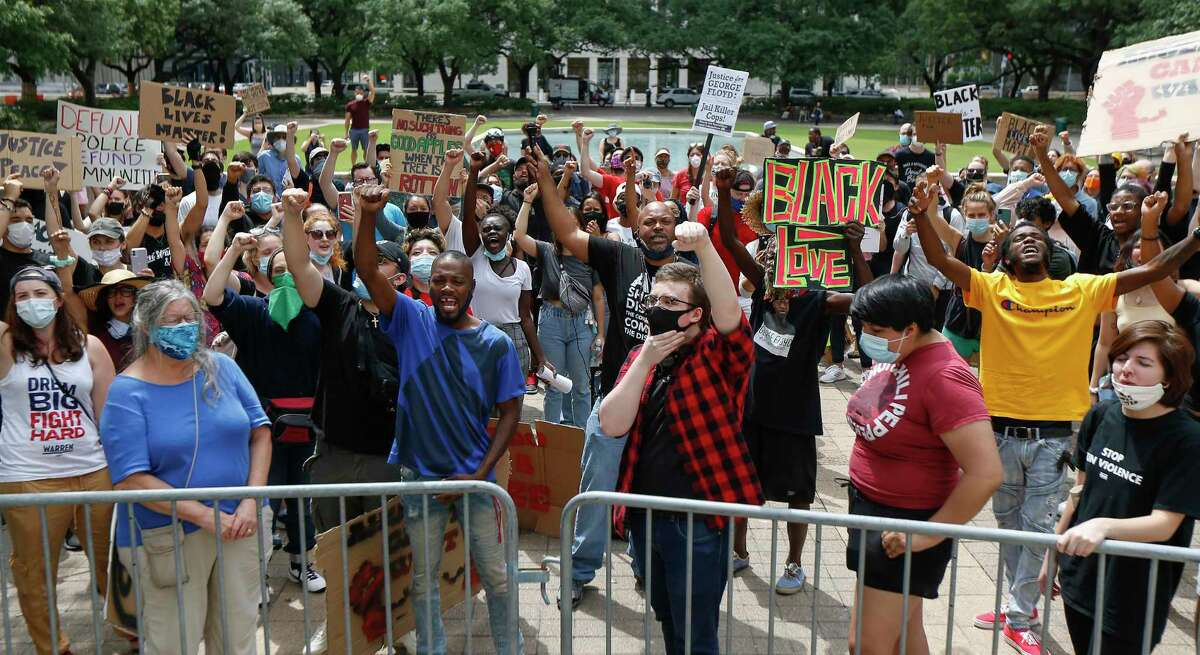 Protesters address City Hall during a rally after the Houston City Council voted against amendments to eliminate police misconduct to the city budget Wednesday, June 10, 2020, in Houston.