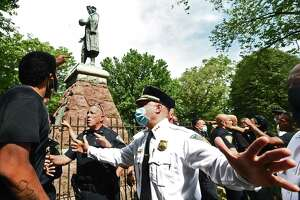 The statue of Christopher Columbus was removed from Wooster Square Park Wednesday afternoon hours after a skirmish erupted early in the morning between people of opposing viewpoints. Later, with a large police presence, hundreds of people gathered to watch the removal of the monument and demonstrate against racism.