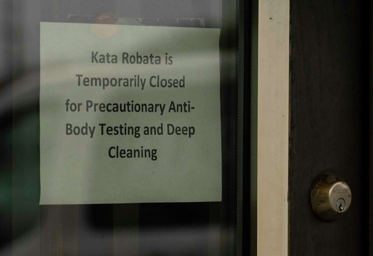 """Kata Robata puts a note on its windows to announce temporary closure after employees tested for antibodies which can show past infection of COVID-19 Monday, June 22, 2020, in Houston. The restaurant stated: """"Per the CDC, antibody tests should not be used to diagnose COVID-19, so all employees who have antibodies--none of whom have or have had symptoms--are being tested virally so we can have more definitive results. Out of precaution, we're closing the restaurant for service until we receive more information. We appreciate your support."""" The restaurant has not announced a reopening date."""