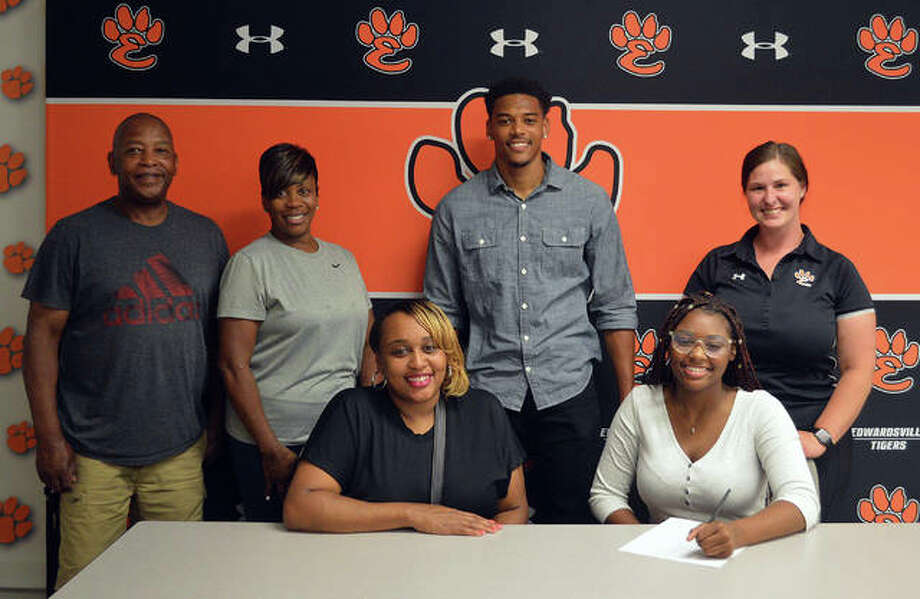 Edwardsville graduate Abreya Deckard, front row right, is joined by her family and EHS coach Jaimee Phegley as she signs to play field hockey at Belmont Abbey College. Photo: Scott Marion/The Intelligencer