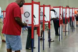 Primary voters cast their ballots at a polling place in Louisville, Ky., on Tuesday, June 23, 2020. The number of voters casting absentee ballots has risen sharply because of the coronavirus pandemic, and the results of key races may not be known on Tuesday night as a result. (Erik Branch/The New York Times)