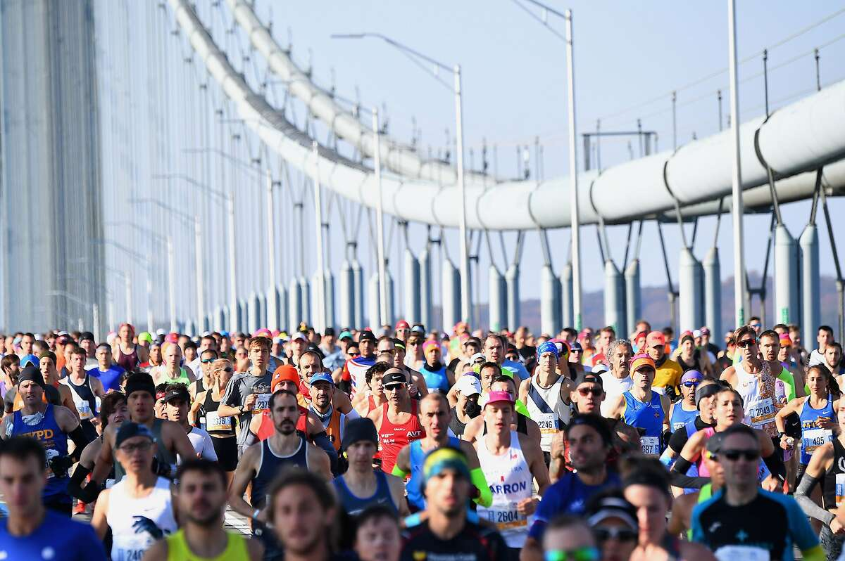 Runners cross the Verrazzano-Narrows Bridge during the 2019 TCS New York City Marathon in New York on Nov. 3, 2019. This year's marathon has been canceled due to the coronavirus. (Johannes Eisele/AFP/Getty Images/TNS)