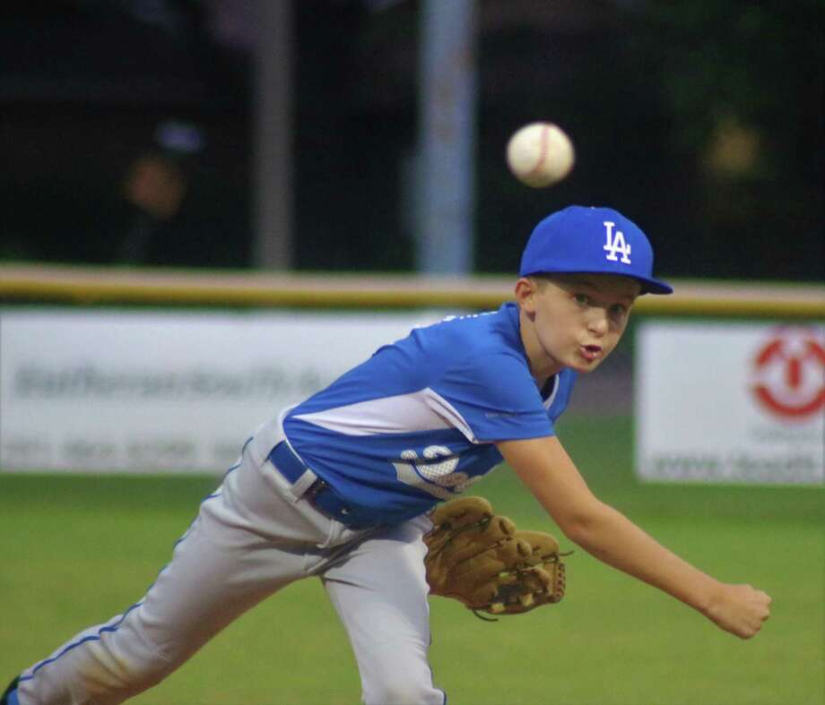 NASA Area Little League pitcher Austin Cotie works on a batter as he tries to keep the Brewers from adding to their score in Tuesday night's game at Steve Alves Field. Photo: Robert Avery