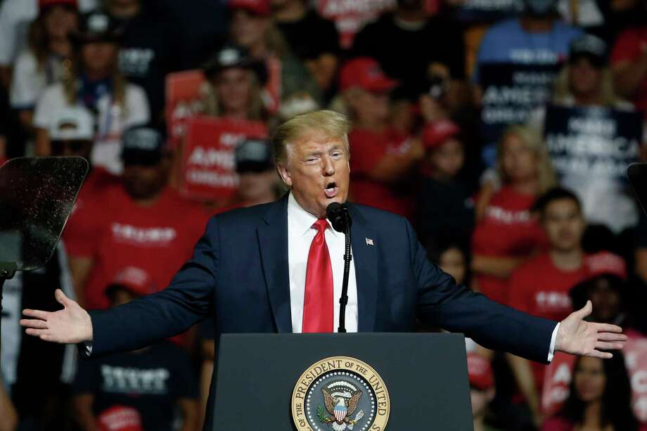 FILE - In this June 20, 2020, file photo, President Donald Trump speaks during a campaign rally in Tulsa, Okla. The coronavirus pandemic isn't going away anytime soon, but campaigns are still forging ahead with in-person organizing. The pandemic upended elections this year, forcing campaigns to shift their organizing activities almost entirely online and compelling both parties to reconfigure their conventions. Photo: Sue Ogrocki, AP / Copyright 2020 The Associated Press. All rights reserved.