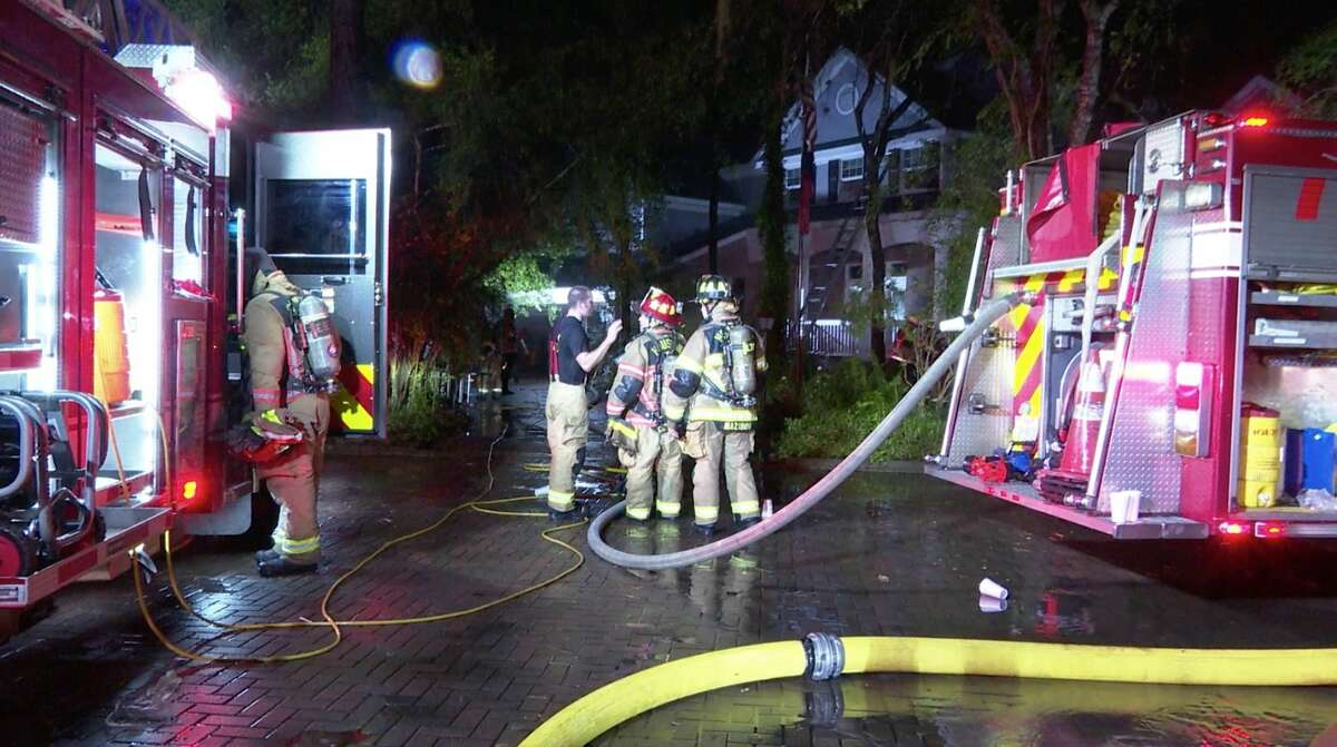 Firefighters battle a house fire in the 1200 block of Provident Oaks Lane after a lightning strike Thursday, June 25, 2020.