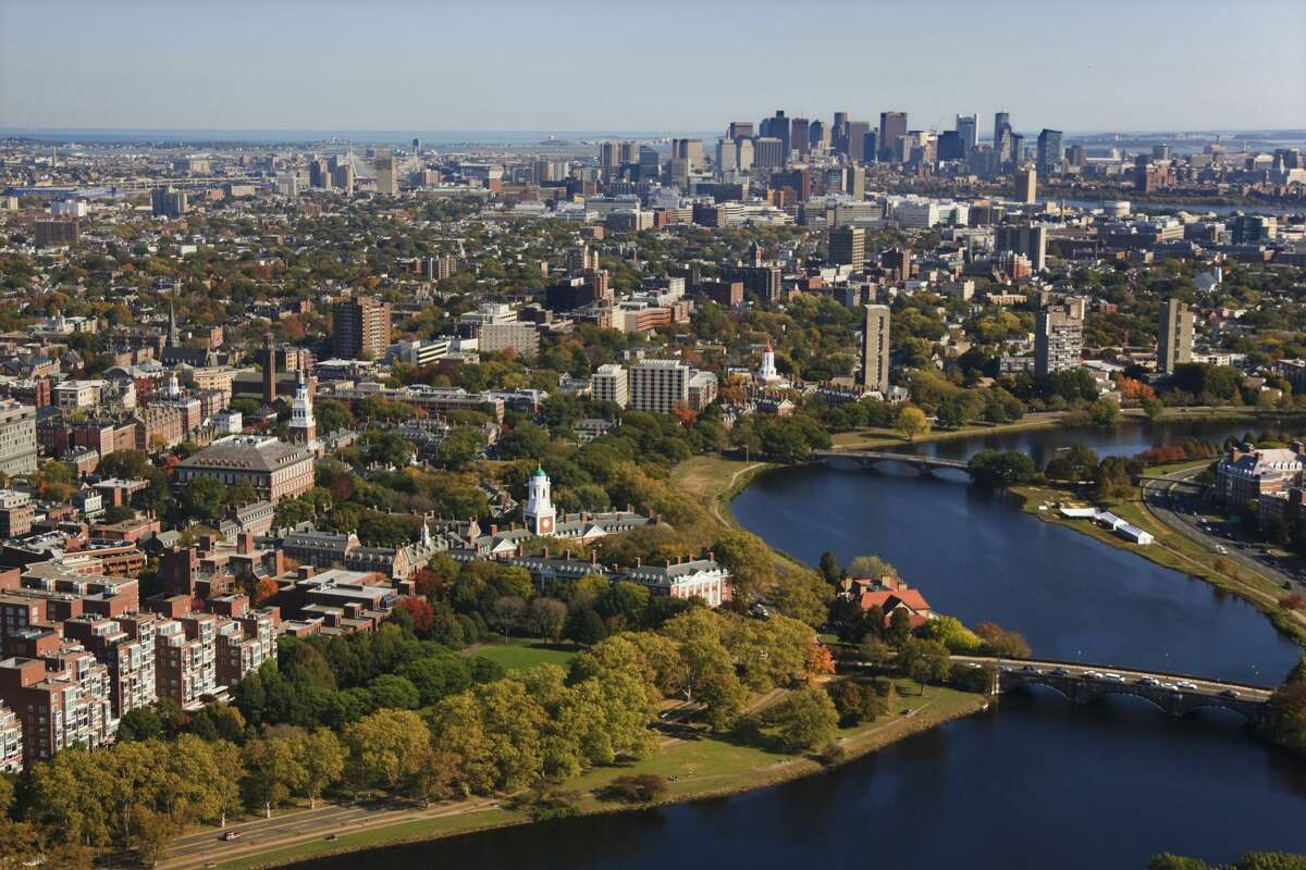 An aerial view of Harvard University and the Charles River in Cambridge, with the Boston skyline in the background. (Photo by Brooks Kraft LLC/Corbis via Getty Images)