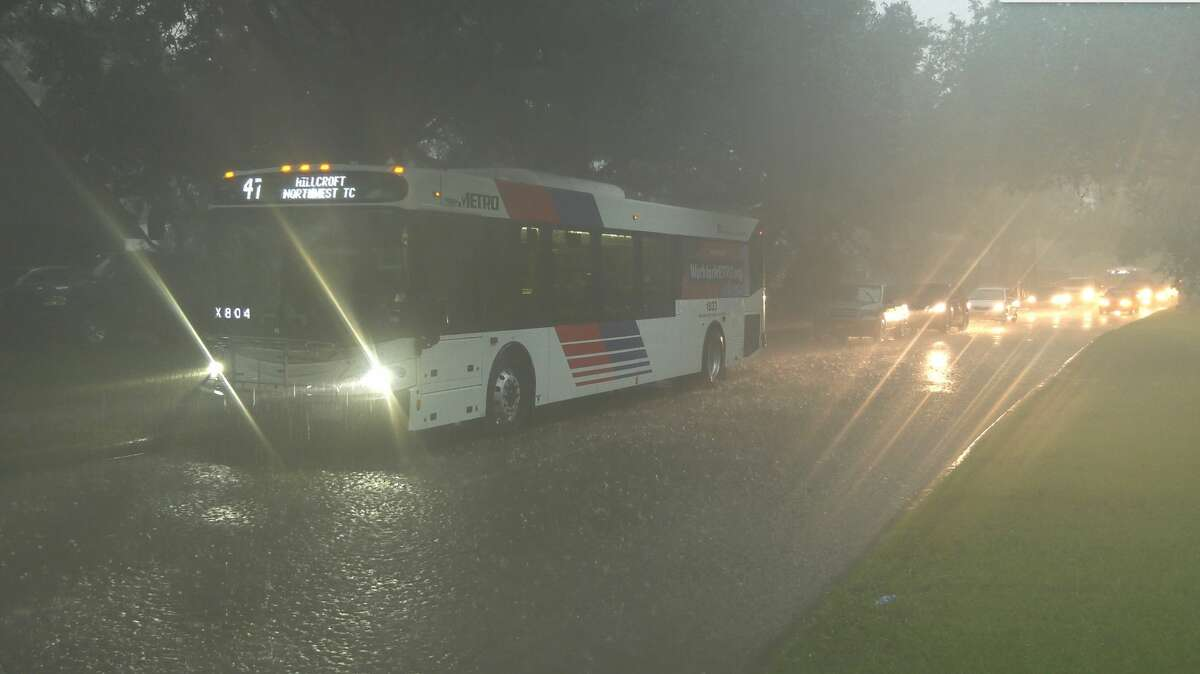A Metro bus is stopped after coming upon a flooded Hillcroft Avenue near Rutherglen Drive on Thursday, June 25, 2020.