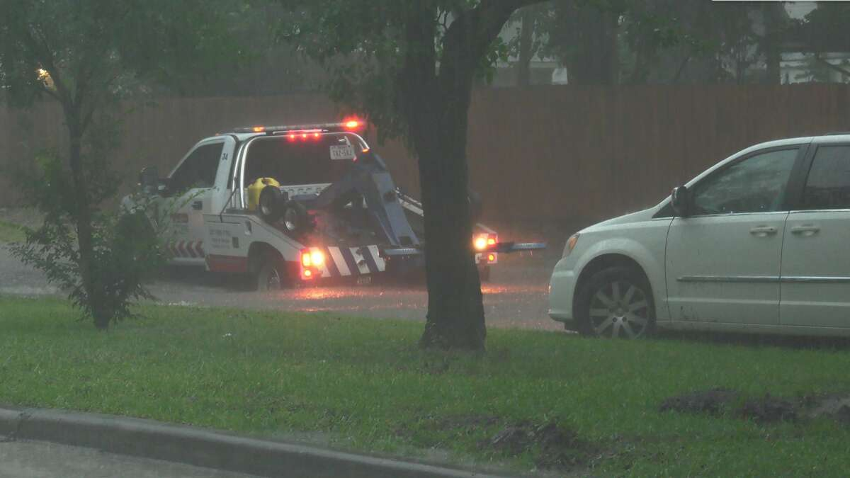 A wrecker driver attempted to help stranded drivers who were caught in a flooded Hillcroft Avenue near Rutherglen Drive on Thursday, June 25, 2020.
