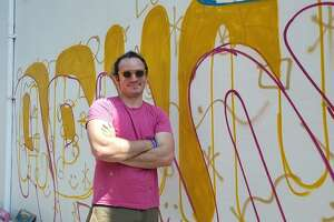 Artist Brian Kaspr spent most of Tuesday creating a mural on the wall of Green & Tonic in downtown Darien.