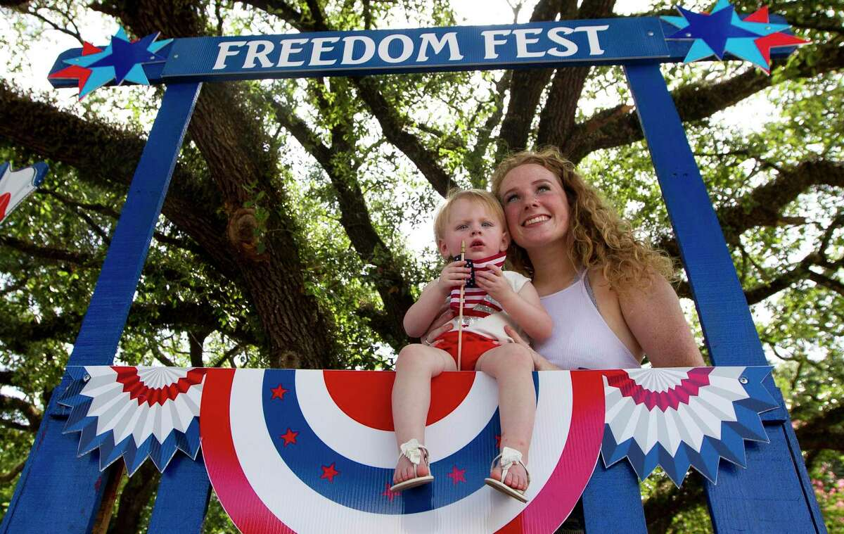 Paige Brown takes a photo with her 15-month-old niece, Presley, during Montgomery's annual Freedom Fest, Saturday, July 6, 2019.