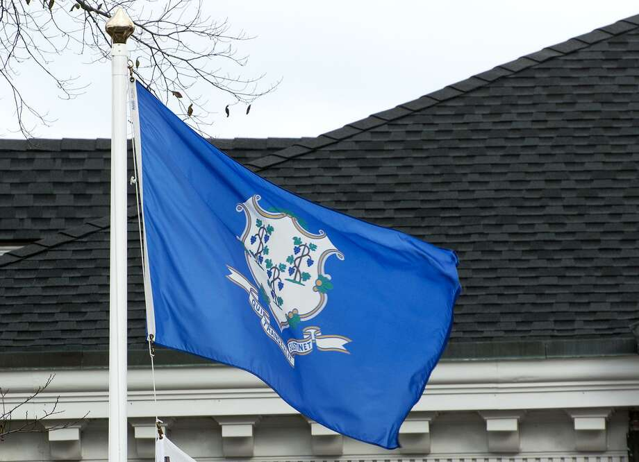 The Connecticut state flag outside town hall in Ridgefield. Photo: Ian Murren / Hearst Connecticut Media / Ridgefield Press