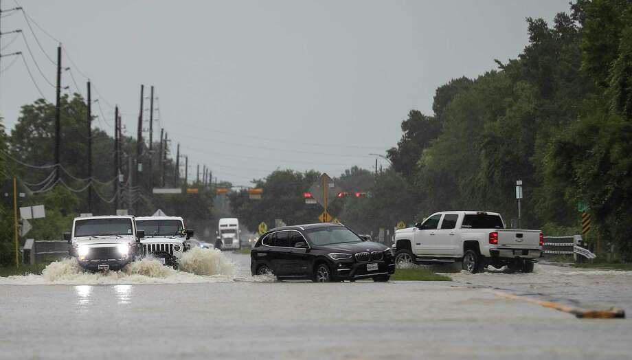 People drive jeeps through high water as areas around South Mayde Creek flood Thursday, June 25, 2020, at the intersection of Greenhouse Road and Saums Road in Houston. Photo: Jon Shapley, Staff Photographer / © 2020 Houston Chronicle