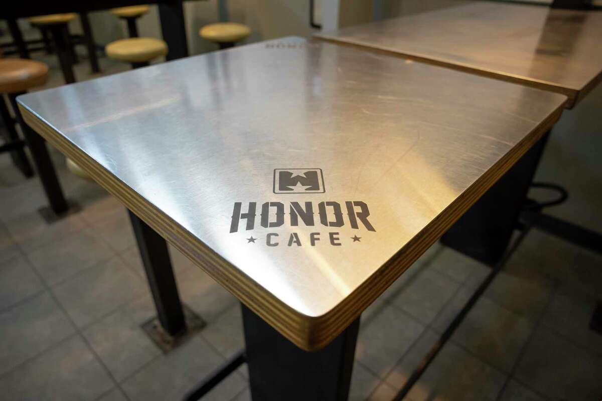 Custom table tops are engraved with the cafe's logo at Honor Cafe near downtown Conroe, Wednesday, June 17, 2020.