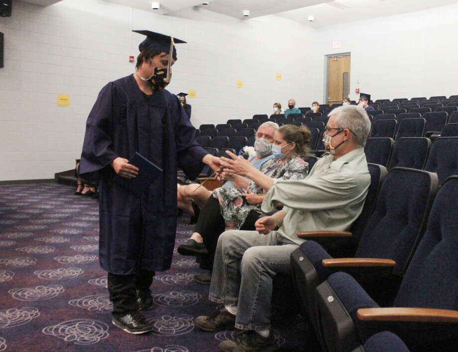 Despite having to maintain safe social distancing and wear face masks to prevent the spread of the coronavirus, members of the Chippewa Hills Mosaic graduating class were all smiles as they collected their diplomas from the auditorium stage Wednesday evening. Photo: Pioneer Photo/Taylor Fussman