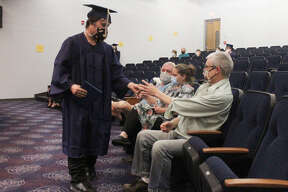 Despite having to maintain safe social distancing and wear face masks to prevent the spread of the coronavirus, members of the Chippewa Hills Mosaic graduating class were all smiles as they collected their diplomas from the auditorium stage Wednesday evening.