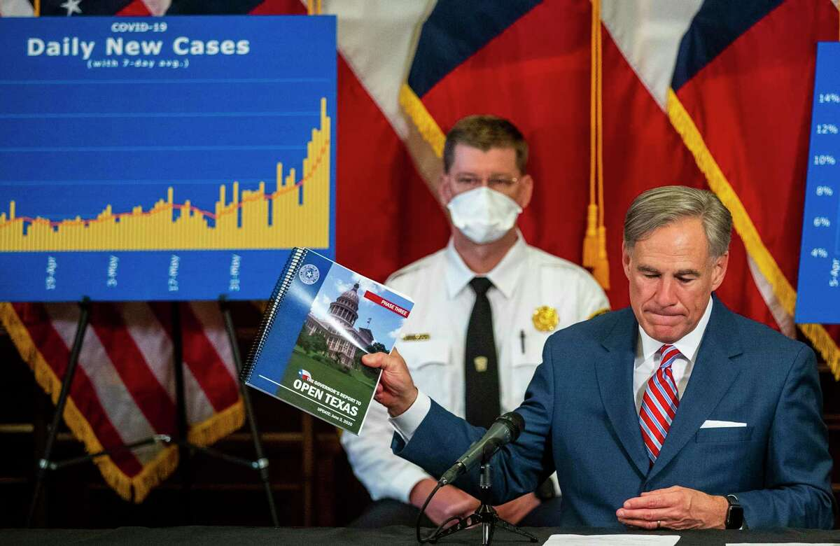 """Gov. Greg Abbott held up his guide to the state reopening during a news conference at the State Capitol in Austin about the coronavirus pandemic Monday, June 22, 2020. Abbott said he had no plans to shut down the state again. """"We must find ways to return to our daily routines as well as finding ways to coexist with COVID-19,"""" Abbott said."""