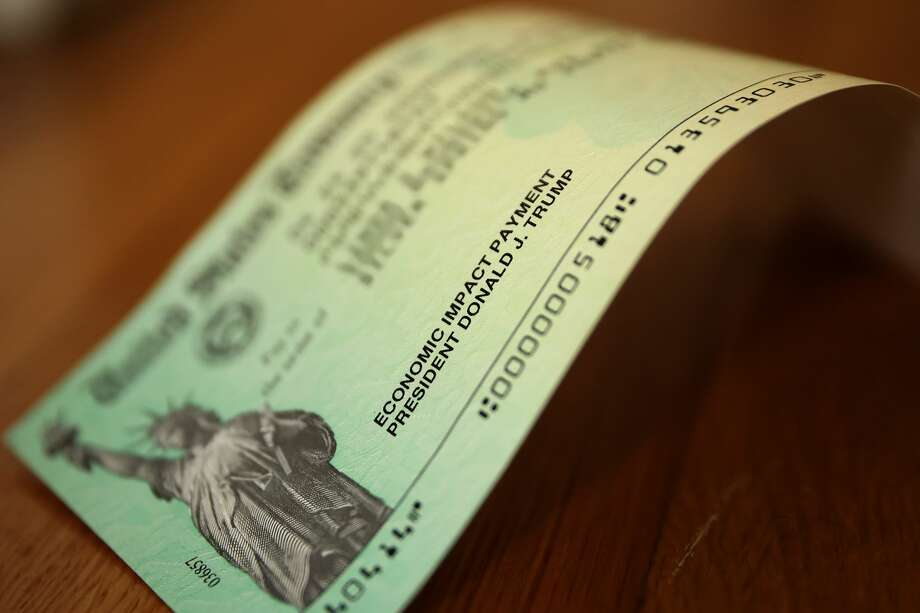 U.S. President Donald Trump's name appears on the coronavirus economic assistance checks that were sent to citizens across the country April 29, 2020 in Washington, DC. (Photo by Chip Somodevilla/Getty Images) Photo: Photo By Chip Somodevilla/Getty Images / 2020 Getty Images