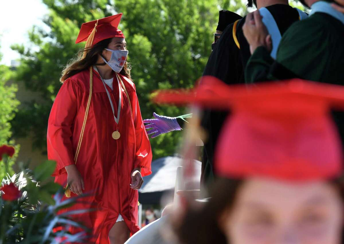 Niskayuna High School senior Kaylee McGill steps up to receive her diploma during a graduation ceremony on Thursday, June 25, 2020, in Niskayuna, N.Y. McGill will attend Rose-Hulman Institute of Technology, according to the school's newsletter. (Will Waldron/Times Union)