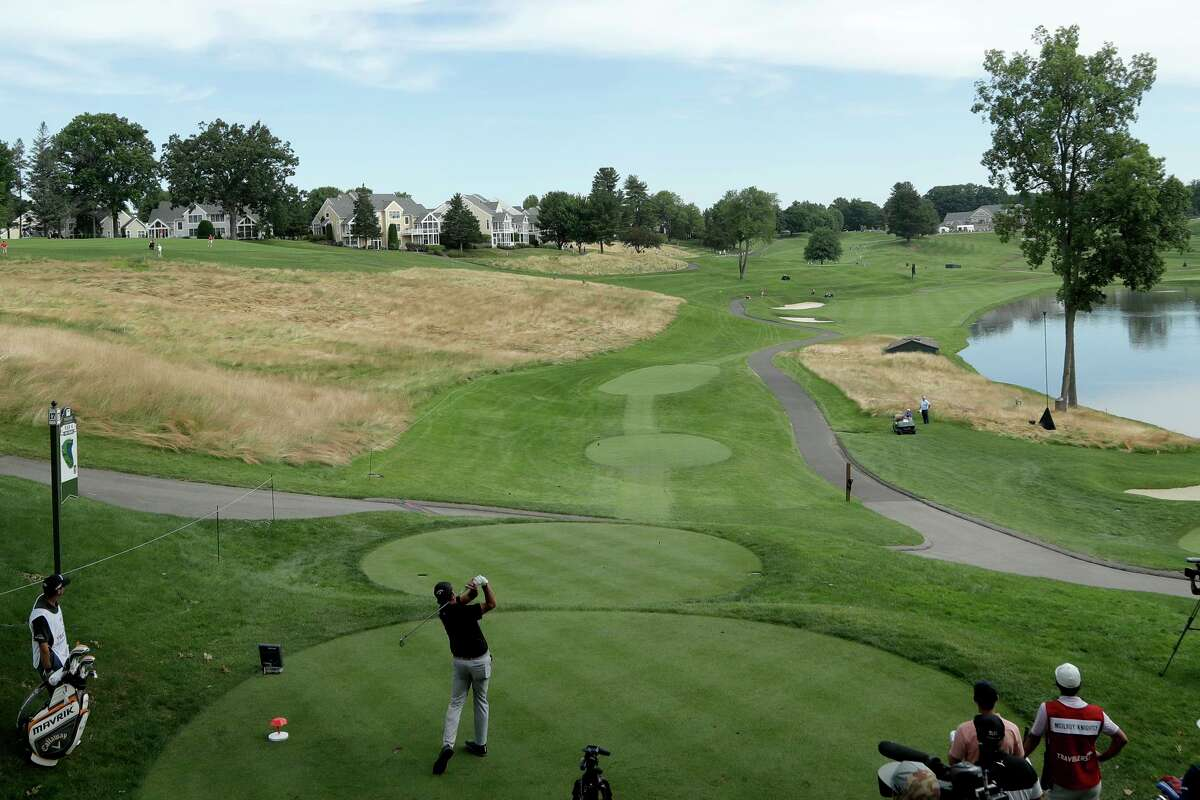 Phil Mickelson tees off from the 17th hole during the first round of the Travelers Championship golf tournament at TPC River Highlands, Thursday, June 25, 2020, in Cromwell, Conn. (AP Photo/Frank Franklin II)