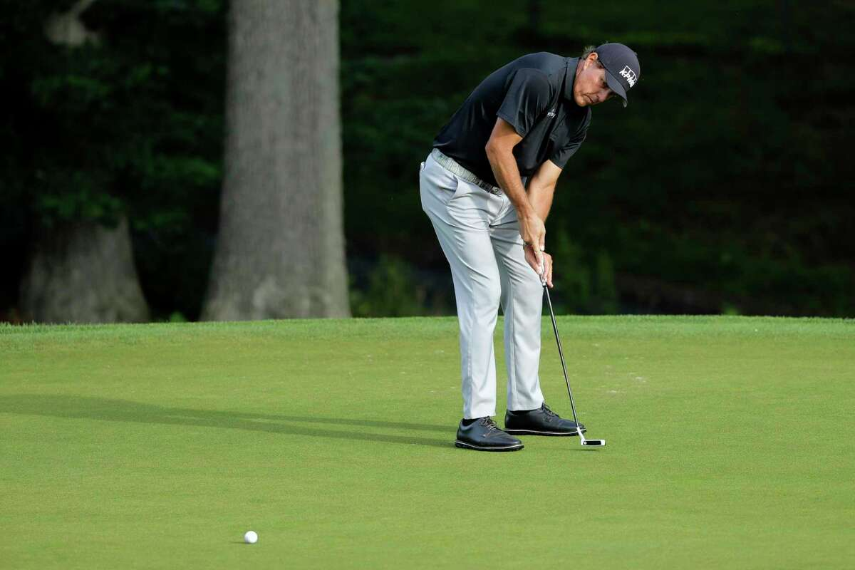 Phil Mickelson putts on the 10th green during the first round of the Travelers Championship golf tournament at TPC River Highlands, Thursday, June 25, 2020, in Cromwell, Conn. (AP Photo/Frank Franklin II)