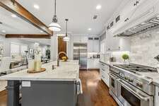 1409 Ashland Street Listing Price: $1,395,000 There's a gourmet island kitchen with a breakfast bar and fridge.