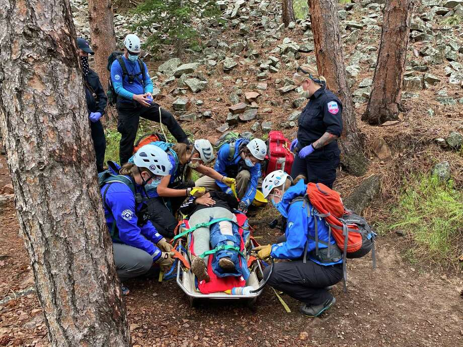 The Rocky Mountain Rescue Group is one of the country's largest all-volunteer search-and-rescue providers. It's protocols for dealing with the coronavirus include wearing surgical masks, long-sleeved shirts, eye protection and gloves. Photo: Handout Photo By Alison Sheets, Rocky Mountain Rescue Group / Rocky Mountain Rescue Group
