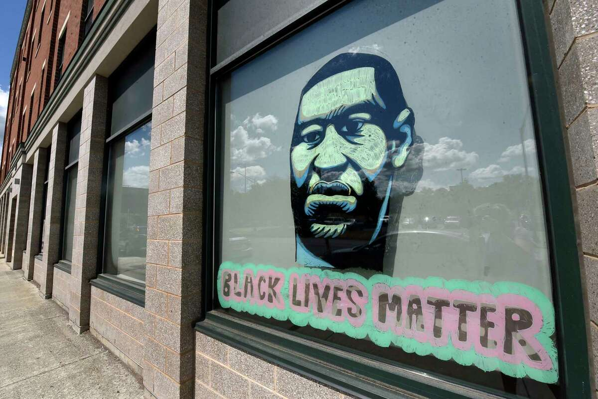 A window on The Unity House is painted with a portrait of George Floyd and black lives matter on Thursday, June 25, 2020 in Troy, N.Y. Floyd died after being restrained by Minneapolis police on May 25, 2020. (Lori Van Buren/Times Union)