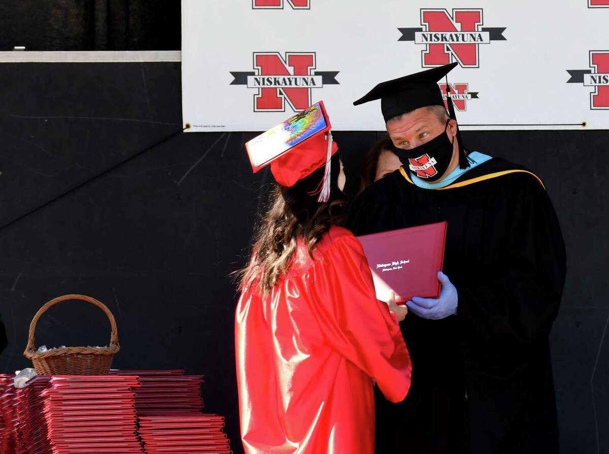 Niskayuna High School Principal John Rickert wears gloves and a mask to comply with coronavirus safety precautions during the school's graduation ceremony on Thursday, June 25, 2020, in Niskayuna, N.Y. Will Waldron/Times Union)