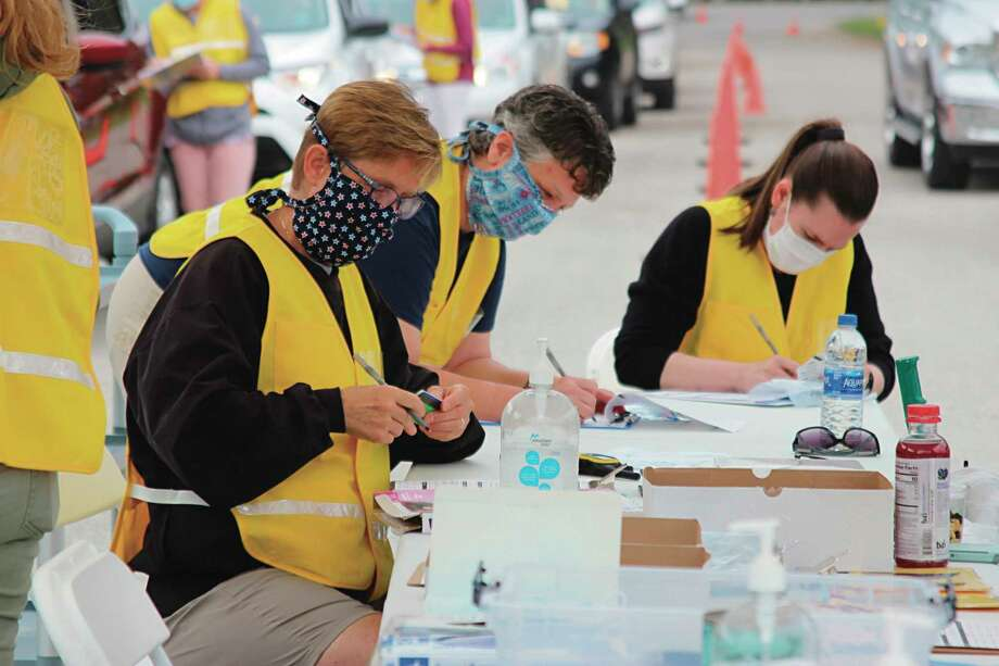Benzie-Leelanau Health Department held a drive-through testing site at Benzie Central High School on June 21. Staff helped guide people arrived for COVID-19 testing. (Colin Merry/Pioneer News Network)