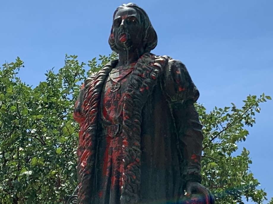 The Christopher Columbus statue in San Antonio has been vandalized with red paint. Photo: Mark Dunphy