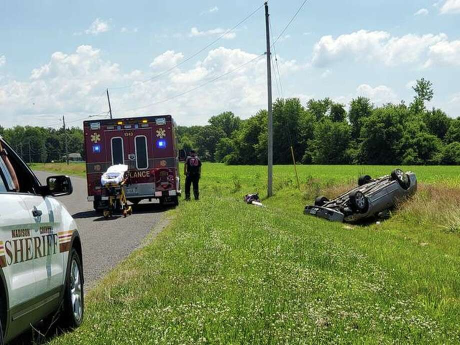 A female driver escape the four-door vehicle after it rolled into a ditch just on the outer limits of Edwardsville on Drda Lane shortly before 11 a.m. Thursday. Photo: Tyler Pletsch | Intelligencer