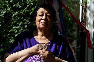 """Mildred Mason, 84, who marched with Martin Luther King Jr. in 1963, holds her """"I Have a Dream"""" medallion from '63 on Thursday, June 25, 2020, outside her house in Schenectady, N.Y. (Will Waldron/Times Union)"""