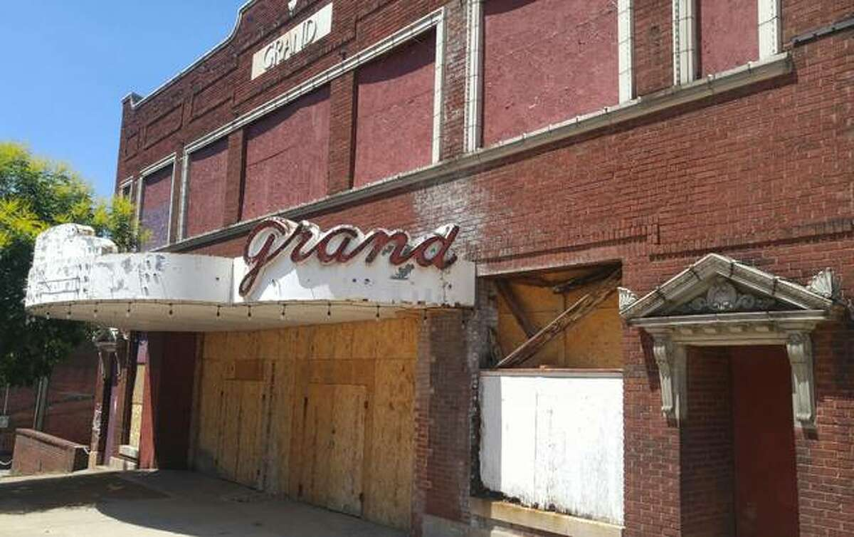 The Grand Theater on Market Street remains boarded up as John and Jayne Simmons and their social impact company AltonWorks re-evaluate revitalization efforts following pandemic concerns this spring. The couple originally planned to complete renovation of the theater by December 2020.