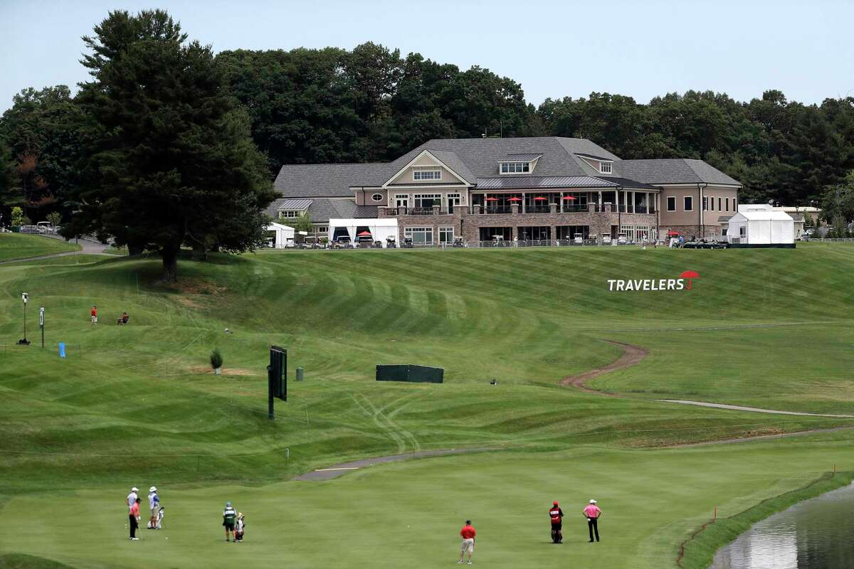 The clubhouse is visible as golfers play through with the absence of fans because of coronavirus restrictions during the first round of the Travelers Championship at TPC River Highlands on June 25 in Cromwell.