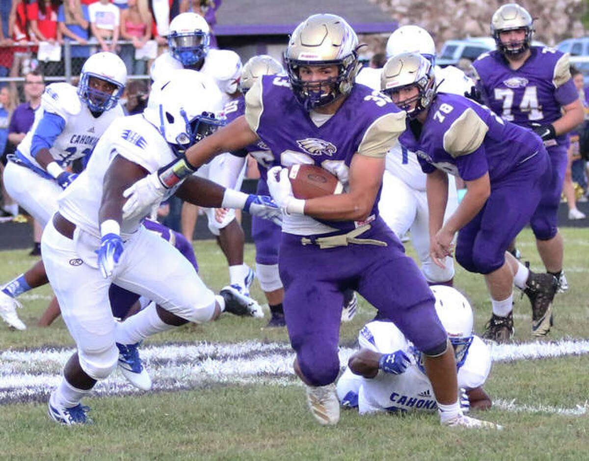 CM's Nick Walker (33) runs for yardage last season. Walker has earned a preferred walk-on invitation at Murray State University. After initially focusing on a college baseball career, Walker switched gears during the COVID pandemic and decided his first love is football.