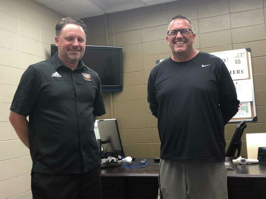 Pictured from left are St. Pius X athletic director Jeff Feller and new football coach Greg Cranfill. Photo: Elliott Lapin / Staff Photo