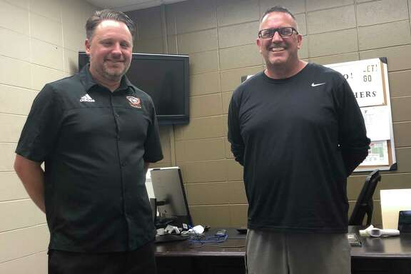 Pictured from left are St. Pius X athletic director Jeff Feller and new football coach Greg Cranfill.