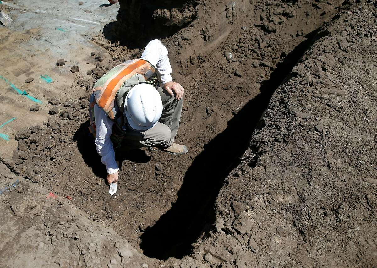 Archeologist Pauk Hoornbeek checks for bone fragments unearthed during construction of the Alameda Creek Watershed Center continues near the Sunol water temple in Sunol, Calif. on Wednesday, June 24, 2020. The site is the ancestral home of the Muwekma Ohlone tribe. When it opens in 2022, the center operated by the SFPUC will offer educational and recreational programs focusing on the Alameda Creek watershed environment.