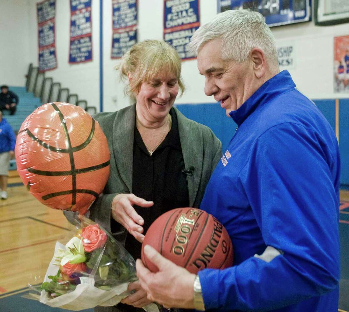 Danbury High School girls basketball Head Coach Jackie DiNardo is presented the game ball by Danbury High School Athletic Director Chip Salvestrini after her 500th victory in a game against Bridgeport Central High School, played at Danbury. Tuesday, Feb. 5, 2019