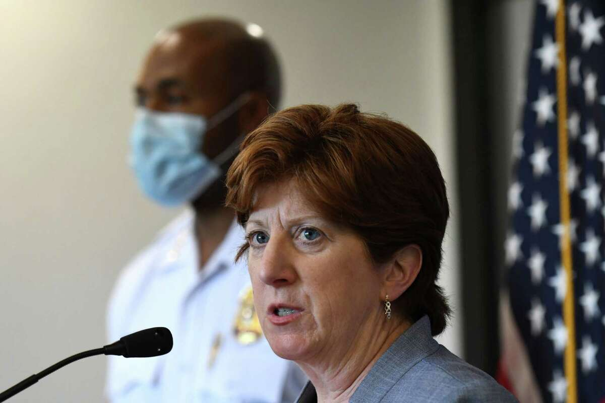 Albany Mayor Kathy Sheehan and Police Chief Eric Hawkins, left, talk to reporters during a June 25, 2020, news conference at police headquarters. The two are facing pressure to address the racial disparities in marijuana arrests in the city. Between last summer and this summer, 97 percent of the people arrested on marijuana charges in the city were Black. (Will Waldron/Times Union)