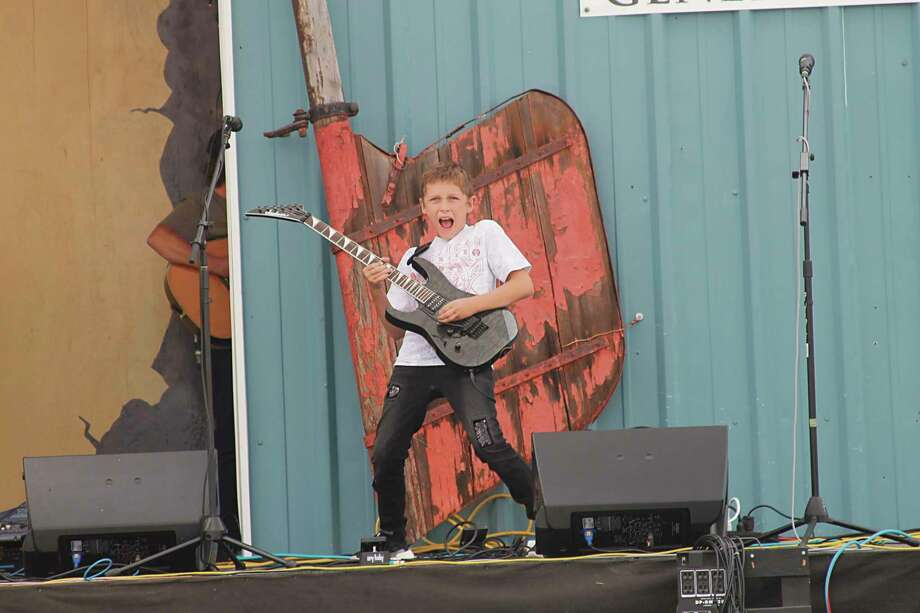 Twelve-year-old Christian Goss, of Traverse City, amazed the crowd at the Minnehaha Brewhaha music festival in Arcadia in 2019 with his guitar skills. (File photo)