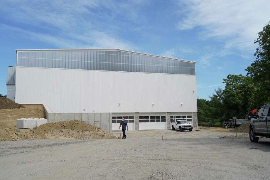 This is the South side of a new gymnasium that New Canaan Country School is building at 635 Frogtown Road. The New Canaan Planning & Zoning Commission will look at the impact of the lighting coming from the building one year after the Certificate of Occupancy [CO] is issued, to determine if the school needs blackout shades on the windows. Photo: Grace Duffield / Hearst Connecticut Media