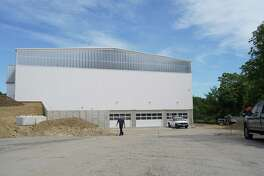 This is the South side of a new gymnasium that New Canaan Country School is building at 635 Frogtown Road. The New Canaan Planning & Zoning Commission will look at the impact of the lighting coming from the building one year after the Certificate of Occupancy [CO] is issued, to determine if the school needs blackout shades on the windows.