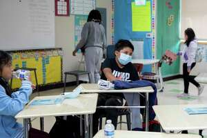Second grade students wear masks while sitting at distanced desks inside their classroom during Freedom School, a six-week summer academic enrichment program for Marin County students held at Bayside Martin Luther King Jr. Academy in Marin City, Calif. Tuesday, June 23, 2020.