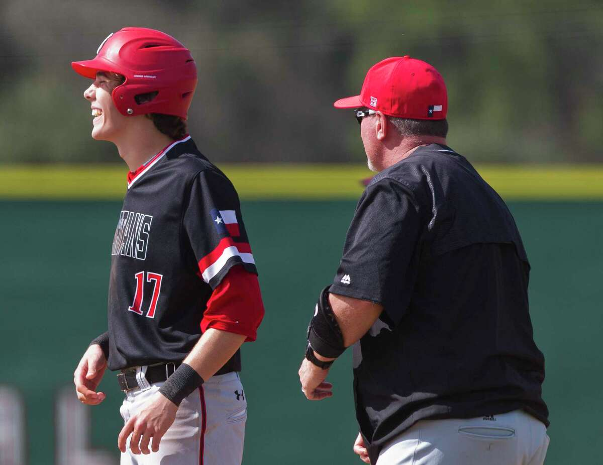 New Caney's new baseball head coach Todd Foley, right, is seen with Zane Russell during the 2018 season coaching first base for Porter High School.