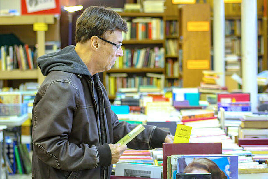 In this November 2019 file photo, a man peruses selections during the St. Andrew's Book Fair in Edwardsville. The fair will be held outdoors this year due to coronavirus threats. Photo: Andrew Malo | For The Intelligencer
