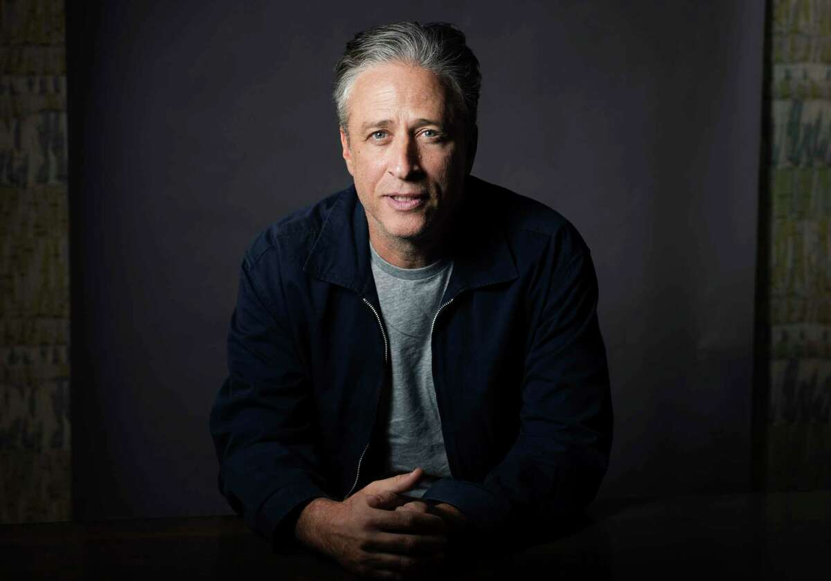"""FILE - In this Nov. 7, 2014 file photo, Jon Stewart poses for a portrait in New York. Stewart directed the comedy """"Irresistible,"""" starring Rose Byrne and fellow """"The Daily Show with Jon Stewart"""" alum, Steve Carell. (Photo by Victoria Will/Invision/AP, File)"""