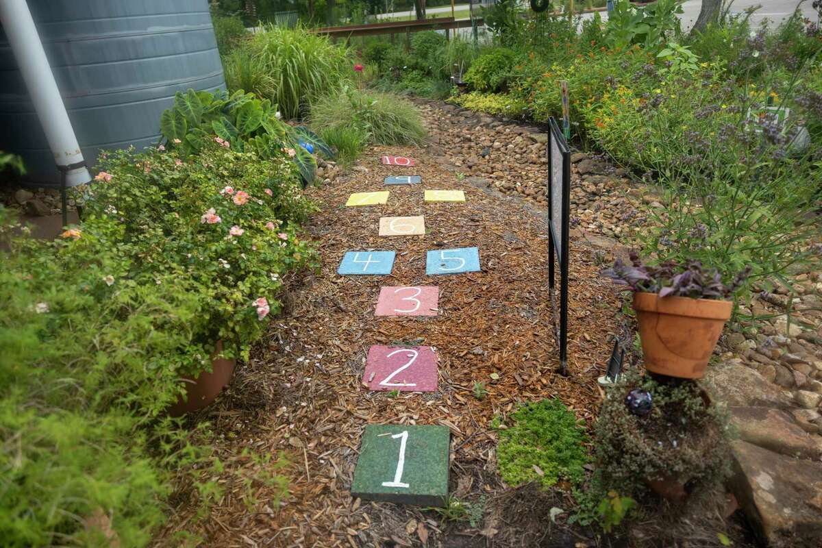 Numbered tile blocks are placed within the Children's Garden for kids to play hop scotch at the Montgomery County Horticulture, Tuesday, June 23, 2020.