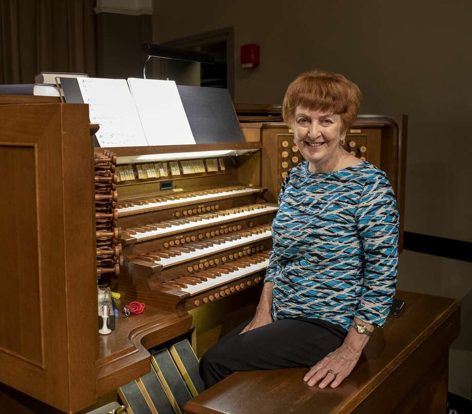 Doris McSparran, music associate and organist, poses the organ Wednesday, June 24, 2020 at First Baptist Church. Photo: Jacy Lewis/Reporter-Telegram / Jacy Lewis/Reporter-Telegram