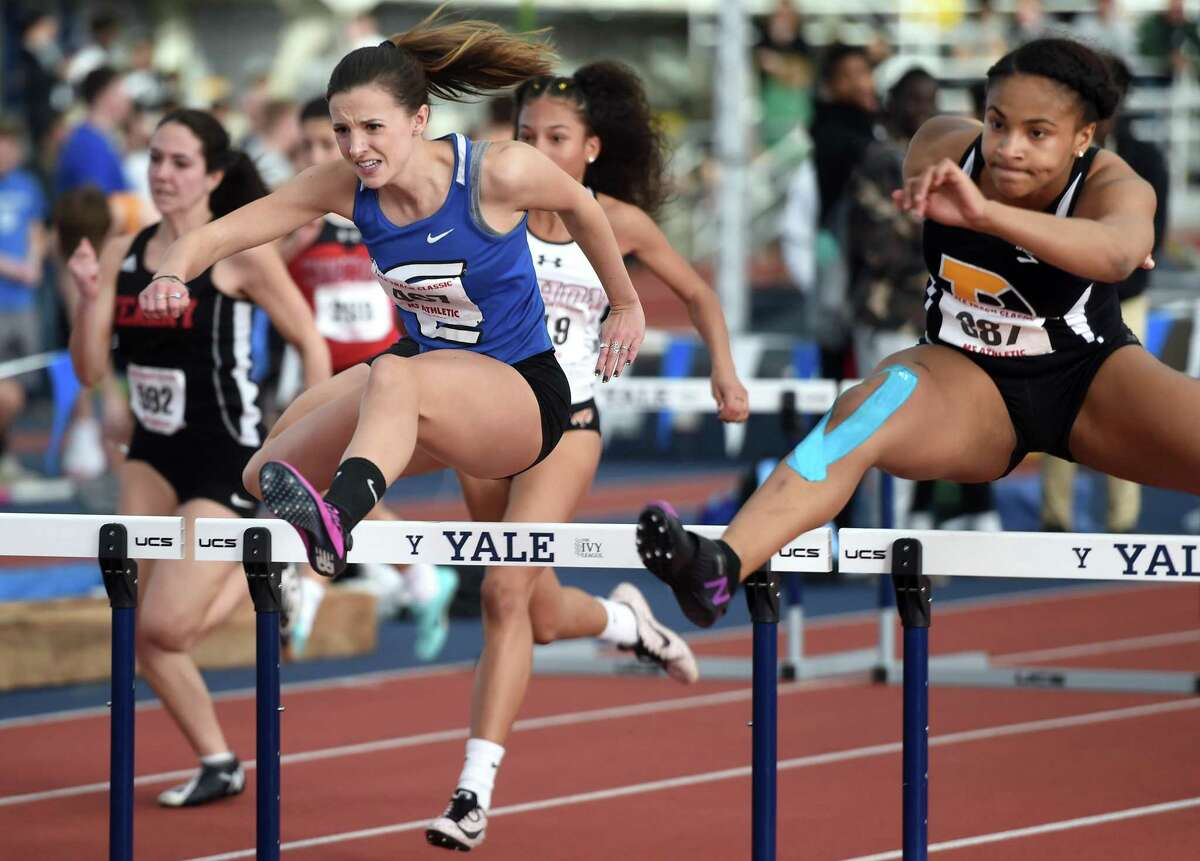 Tess Stapleton (left) of Fairfield Ludlowe is inched out by Jia Anderson of Padua in the girls 55 meter hurdles championship finals at the Yale Interscholastic Track Classic at Coxe Cage in New Haven on January 11, 2020.